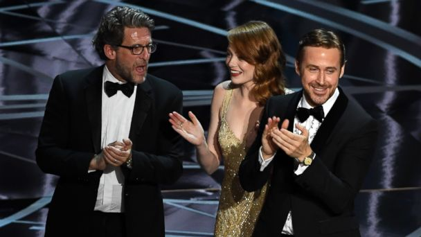 PHOTO: Producer Gary Gilbert, actors Emma Stone and Ryan Gosling celebrate 'La La Land' winning Best Picture due to a presentation error onstage during the 89th Annual Academy Awards at Hollywood & Highland Center, on Feb. 26, 2017, in Hollywood, Calif.