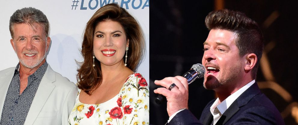 PHOTO: Alan Thicke with wife Tanya Callau, left, and Robin Thicke, right.