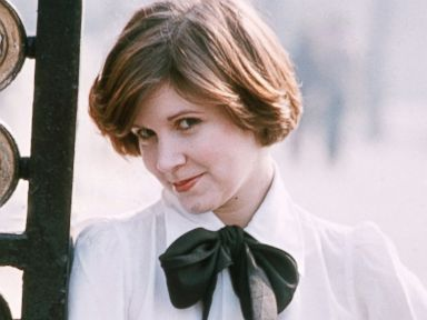 PHOTO: Carrie Fisher poses for a photo against metal gate, Feb. 1, 1975.