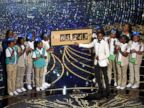 PHOTO: Host Chris Rock presents the amount of money collected during the show by the Girl Scouts, including Rocks daughters Zahra and Lola, onstage at the 88th Annual Academy Awards at the Dolby Theatre, Feb. 28, 2016, in Hollywood, California.