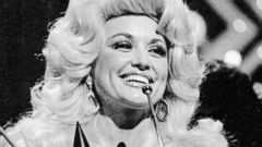 "PHOTO: Dolly Parton accepts the award for ""Female Vocalist of the Year"" during this Country Music Associations televised awards show, Oct. 13, 1975."