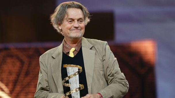 PHOTO: Director Jonathan Demme poses with his tribute award at the 12th Marrakesh International Film Festival on December 6, 2012 in Marrakesh.