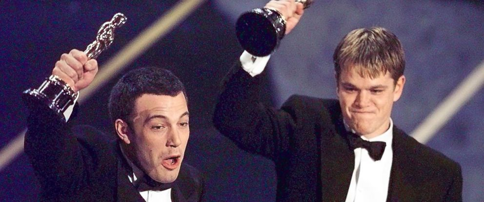PHOTO: Ben Affleck and Matt Damon hold up their Oscars after winning in the Original Screenplay Category during the 70th Academy Awards at the Shrine Auditorium.
