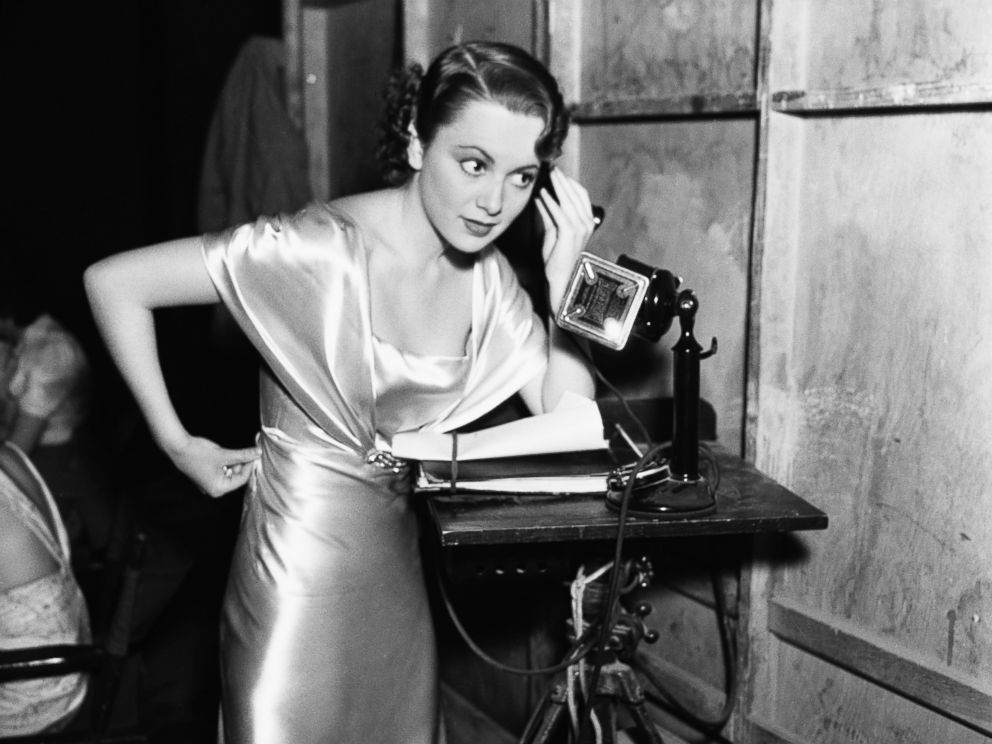 PHOTO: Olivia De Havilland standing in an undated photo with telephone to her ear.