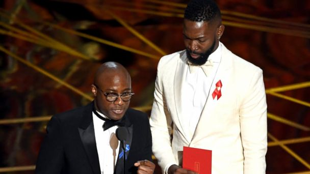 PHOTO: Writer/director Barry Jenkins and writer Tarell Alvin McCraney accept Best Adapted Screenplay for 'Moonlight' onstage during the 89th Annual Academy Awards, Feb. 26, 2017, in Hollywood, Calif.