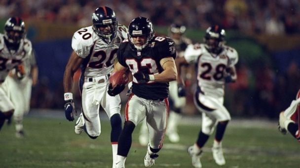 PHOTO: Tim Dwight of the Atlanta Falcons is pursued by corner back Tory James of the Denver Broncos as he returns a kick-off for a touchdown during Super Bowl XXXIII in Miami, Florida.