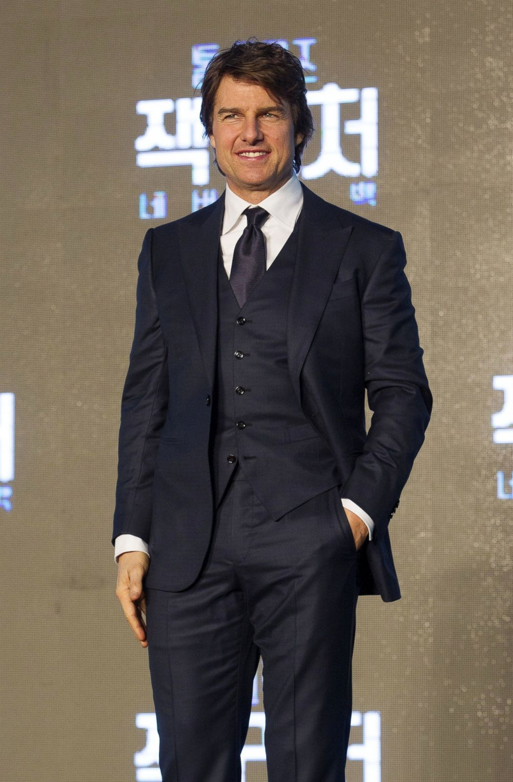 Tom Cruise Hits The Red Carpet In A Three Piece Suit