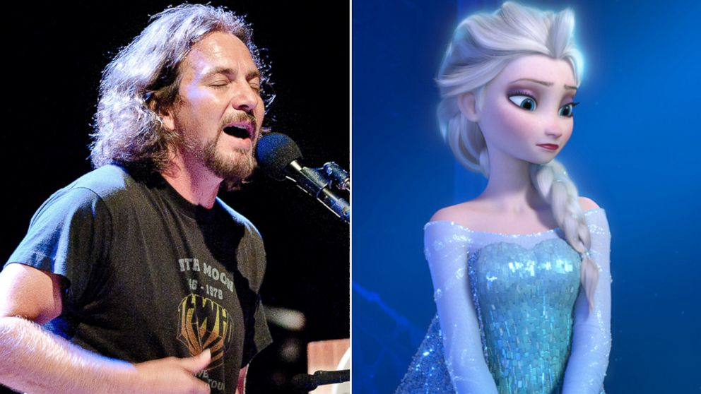 PHOTO: Eddie Vedder, lead singer of Pearl Jam, left, performs during his concert at the Royal Theatre Carre in Amsterdam, July 25, 2012. Elsa from the movie, Frozen.