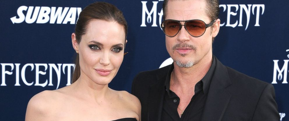 """PHOTO: Angelina Jolie and Brad Pitt at the World Premiere Of Disneys """"Maleficent"""" at the El Capitan Theatre in Hollywood, California, May 28, 2014."""