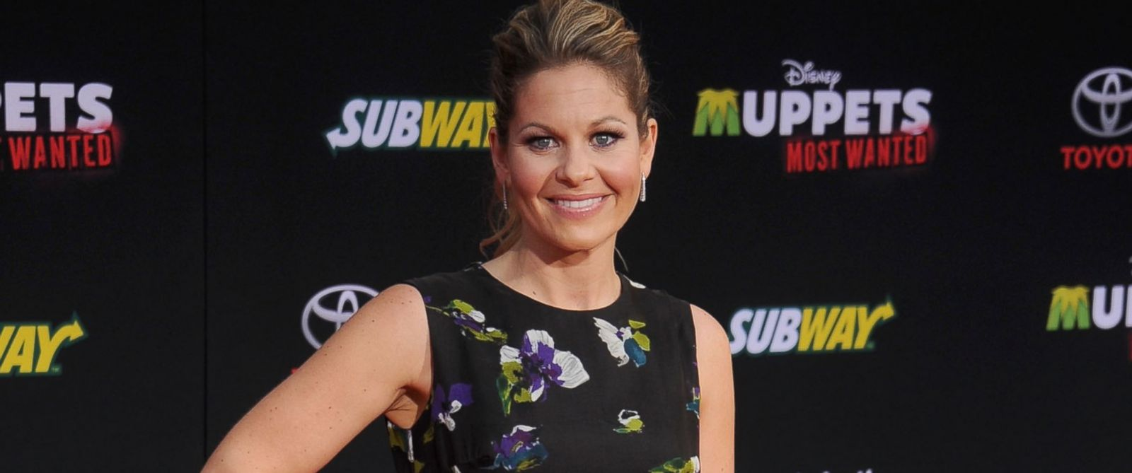 """PHOTO: Actress Candace Cameron Bure arrives at the Los Angeles premiere of """"Muppets Most Wanted"""" at the El Capitan Theatre, March 11, 2014 in Hollywood, Calif."""