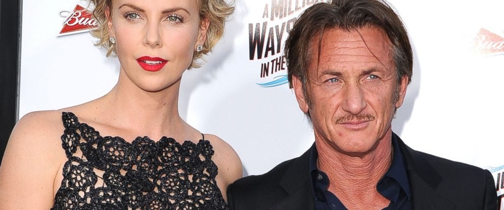 """PHOTO: Charlize Theron and Sean Penn arrives at the """"A Million Ways To Die In The West"""" - Los Angeles Premiere at Regency Village Theatre, May 15, 2014, in Westwood, Calif."""