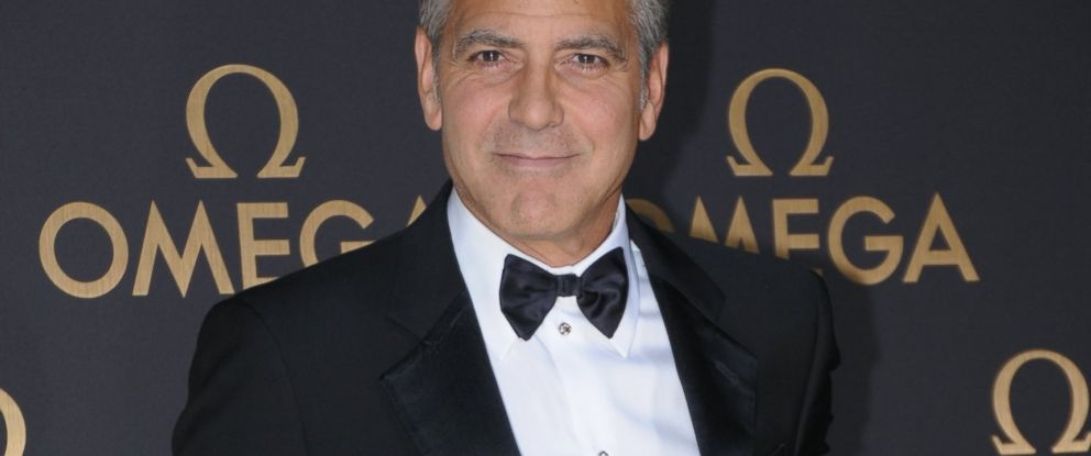 PHOTO: Actor George Clooney arrives for the red carpet of Omega Le Jardin Secret dinner party, May 16, 2014 in Shanghai.