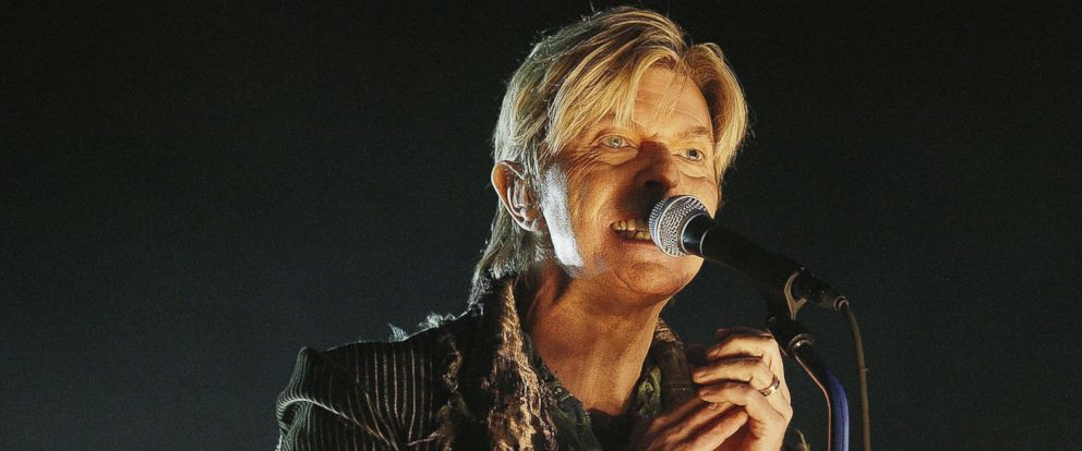 PHOTO: David Bowie performs on stage on June 13, 2004 in Newport, UK.