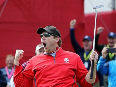 PHOTO: Fan David Johnson of North Dakota reacts after being pulled from the crowd and making a putt on the eighth green during practice prior to the 2016 Ryder Cup at Hazeltine National Golf Club, on Sept. 29, 2016, in Chaska, Minnesota.