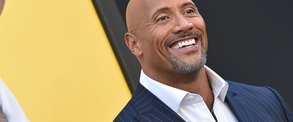 PHOTO: Actor Dwayne Johnson arrives at the premiere of Warner Bros. Pictures Central Intelligence at Westwood Village Theatre, June 10, 2016, in Westwood, California.