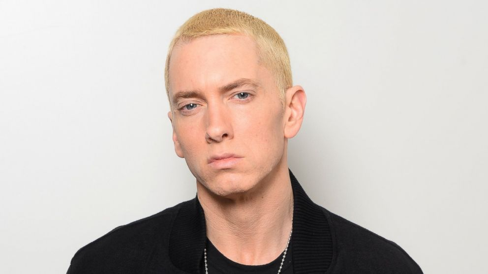 PHOTO: Eminem poses in his dressing room with the Best Hip Hop and Global Icon awards during the MTV EMAs 2013 at the Ziggo Dome on November 10, 2013 in Amsterdam, Netherlands.