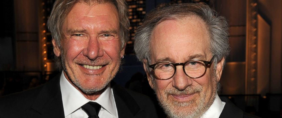 PHOTO: Harrison Ford and AFI Board Member Steven Spielberg pose in the audience during the 38th AFI Life Achievement Award honoring Mike Nichols held at Sony Pictures Studios on June 10, 2010 in Culver City, Calif.