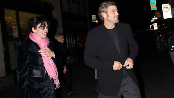 PHOTO: Actors George Clooney and Karen Duffy leave Ciprianis Restaurant after dinner with friends November 26, 2001 in New York.