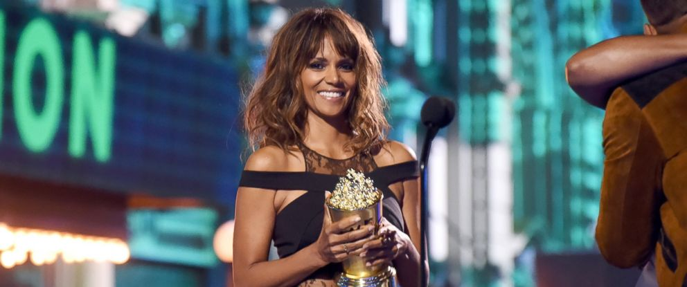 PHOTO: Halle Berry presents the Generation Award to actor Will Smith onstage during the 2016 MTV Movie Awards at Warner Bros. Studios on April 9, 2016 in Burbank, California.