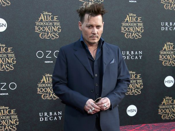 Photos:  Johnny Depp Strikes a Pose at Premiere
