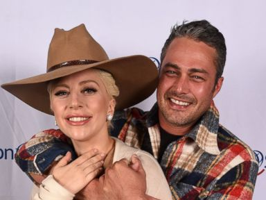Lady Gaga and Fiance Taylor Kinney Snuggle Up on the Red Carpet