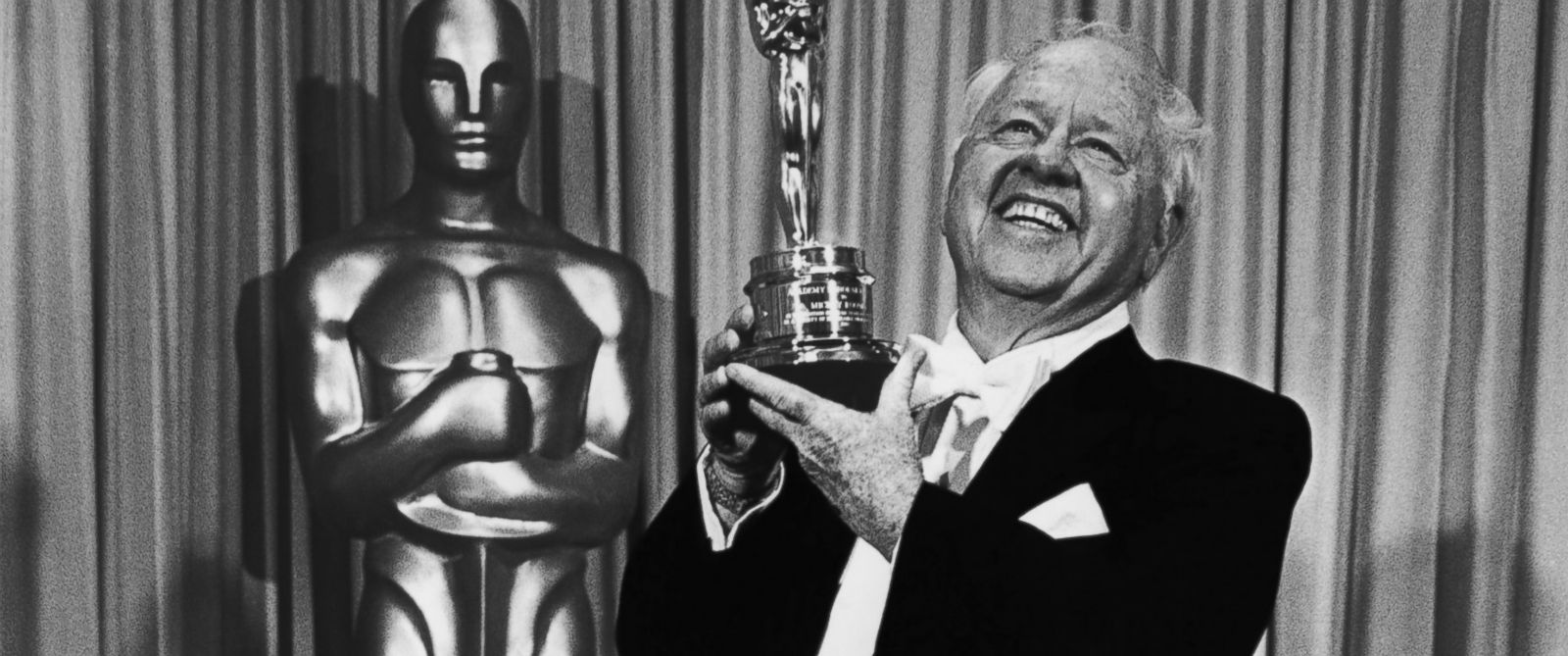 "PHOTO: Film actor Mickey Rooney poses with the ""Lifetime Achievement"" Academy Award backstage, following his acceptance speech, at the 1982 Academy Awards in Los Angeles, California."