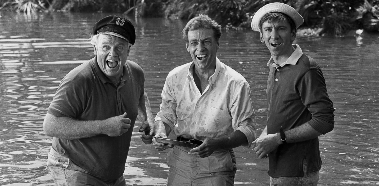 "PHOTO: Alan Hale Jr. as the Skipper, Russell Johnson as the Professor and Bob Denver as Gilligan stand knee-deep in water in the ""Two On a Raft"" episode of the television show ""Gilligans Island."" 1966."