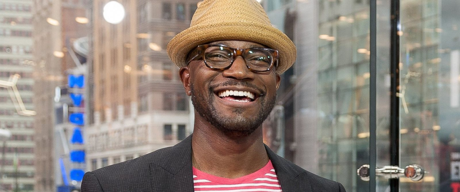 "PHOTO: Taye Diggs visits ""Extra"" at their New York studios at H&M in Times Square on June 5, 2014 in New York City."