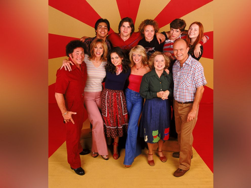 PHOTO: The cast of That 70s Show, Top row, L-R: Wilmer Valderrama, Ashton Kutcher, Danny Masterson, Topher Grace, Laura Prepon. Center L-R: Don Stark, Tanya Roberts, Mila Kunis, Lisa Robin Kelly, Debra Jo Rupp and Kurtwood Smith.