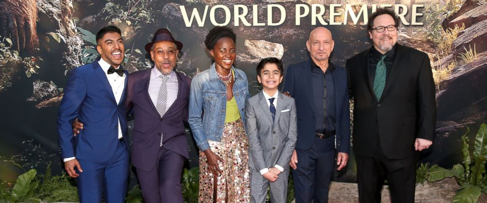 """Actor Ritesh Rajan, actor Giancarlo Esposito, actress Lupita Nyongo, actor Neel Sethi, actor Ben Kingsley and director/producer Jon Favreau attend the premiere of Disneys """"The Jungle Book"""" at the El Capitan Theatre, April 4, 2016, in Hollywood, Calif."""
