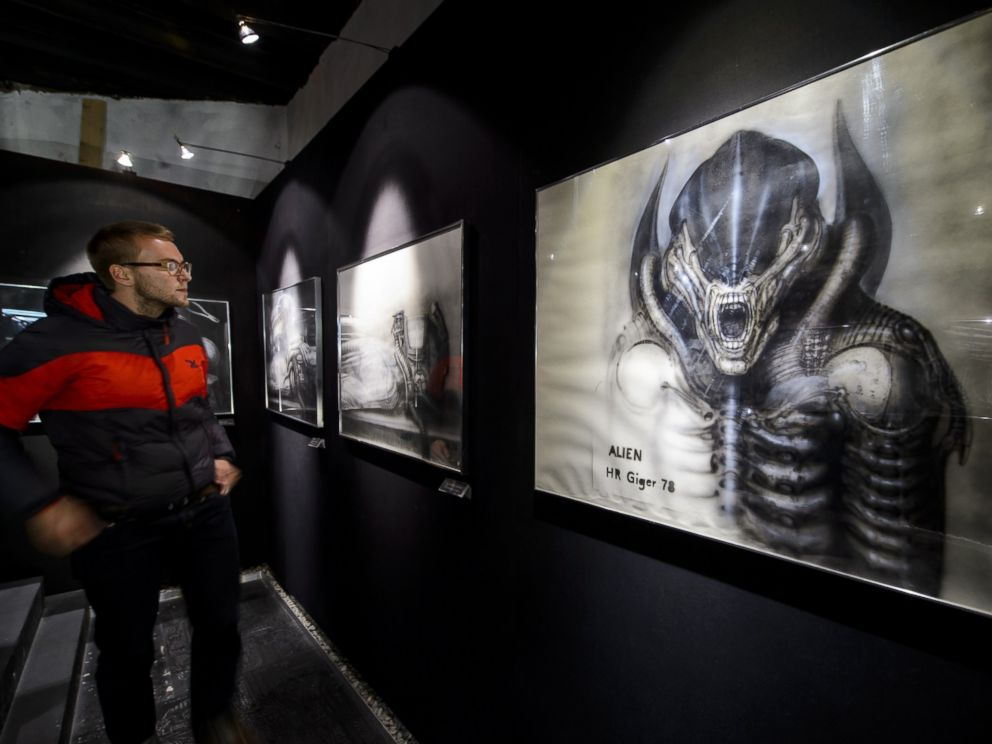 PHOTO: A visitor faces a preparatory sketch for Alien movie at the HR Giger Museum on May 13, 2014 in Gruyeres.