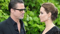 """PHOTO: Brad Pitt and Angelina Jolie attends a private reception as costumes and props from Disneys """"Maleficent"""" are exhibited in support of Great Ormond Street Hospital at Kensington Palace, May 8, 2014, in London."""