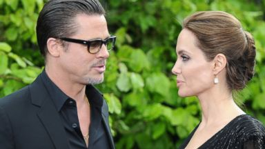PHOTO: Brad Pitt and Angelina Jolie attends a private reception as costumes and props from Disneys Maleficent are exhibited in support of Great Ormond Street Hospital at Kensington Palace, May 8, 2014, in London.