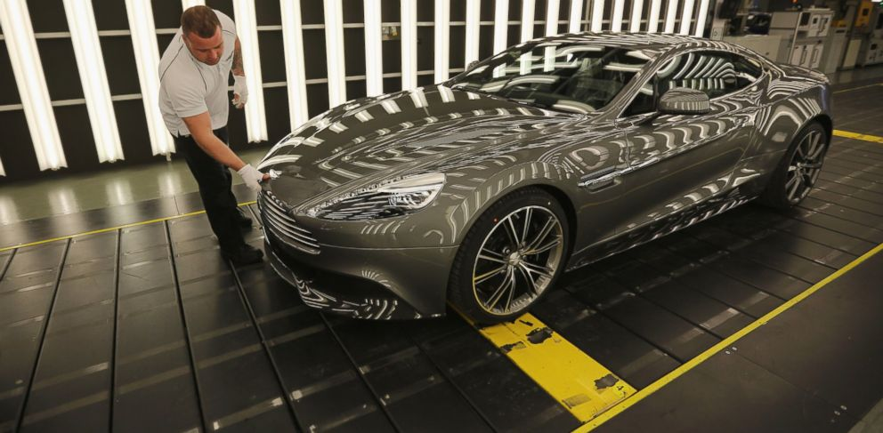PHOTO: In this file photo, an Aston Martin Vanquish is inspected by hand inside a light booth at the company headquarters and production plant on Jan. 10, 2013 in Gaydon, England.