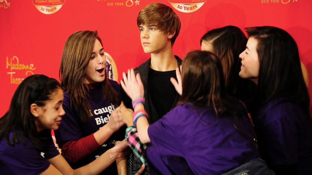 PHOTO: In this file photo, fans of Justin Bieber crowd his wax figure during its unveiling ceremony at Madame Tussauds on Mar. 15, 2011 in New York City.