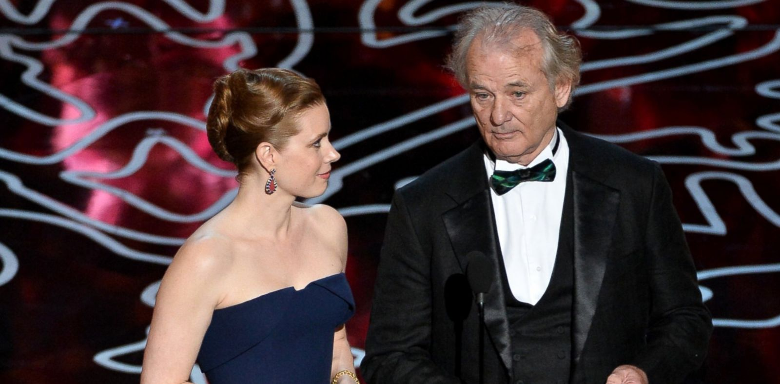 PHOTO: Amy Adams, left, and Bill Murray, right, speak onstage during the Oscars on Mar. 2, 2014 in Hollywood, Calif.