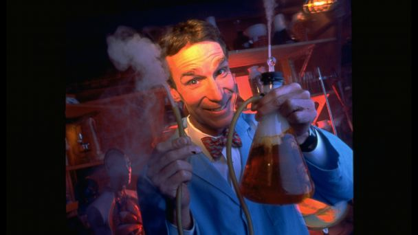 PHOTO: Science educator/TV personality Bill Nye holding up steaming tube & beaker in studio lab of his PBS TV series Bill Nye the Science Guy.