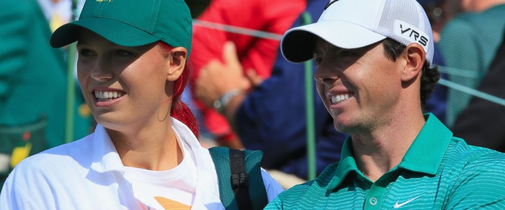 PHOTO: Caroline Wozniacki, left, and Rory McIlroy, right, are pictured on April 9, 2014 in Augusta, Ga.