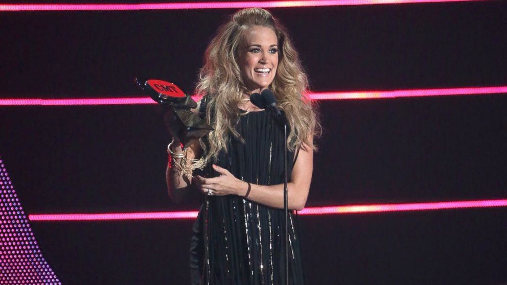 PHOTO: Carrie Underwood accepts an award on stage during the 2014 CMT Music awards at the Bridgestone Arena, June 4, 2014 in Nashville, Tenn.