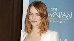 Emma Stone Sparkles In White