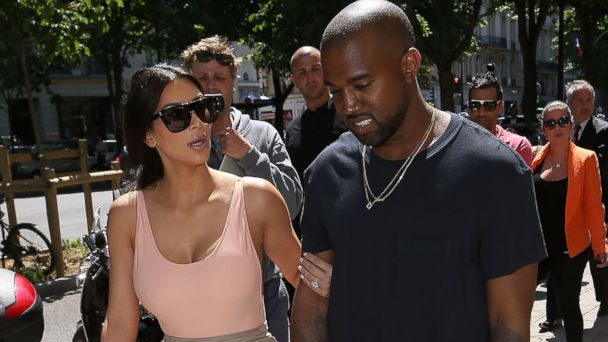 PHOTO: Kim Kardashian, left, and Kanye West, right, are seen strolling in Paris, France on May 19, 2014.