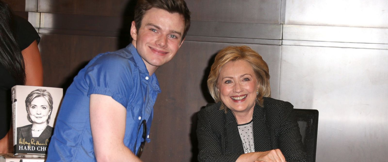 "PHOTO: Chris Colfer poses for a photo with Hillary Rodham Clinton during a book signing for ""Hard Choices"" at Barnes & Noble at The Grove in Los Angeles, June 19, 2014."