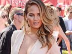 Chrissy Teigen Rocks a Plunging Jumpsuit