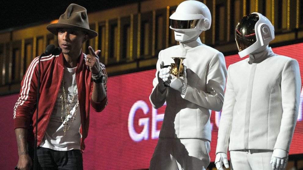 PHOTO: Pharrell Williams, and Daft Punks Thomas Bangalter and Guy-Manuel de Homem-Christo accepts awards onstage during the 56th GRAMMY Awards at Staples Center, Jan. 26, 2014, in Los Angeles.