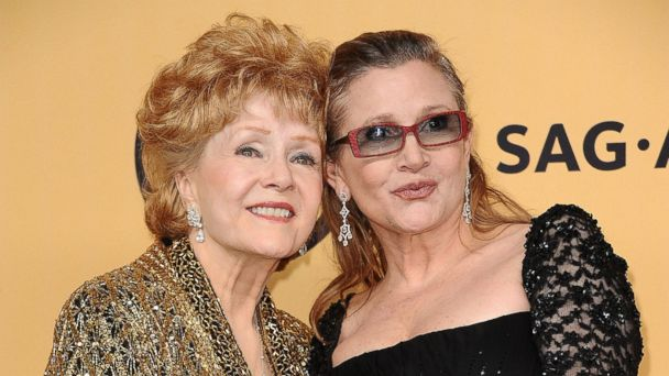 PHOTO: Actresses Debbie Reynolds and Carrie Fisher pose in the press room at the 21st annual Screen Actors Guild Awards at The Shrine Auditorium, Jan. 25, 2015, in Los Angeles.