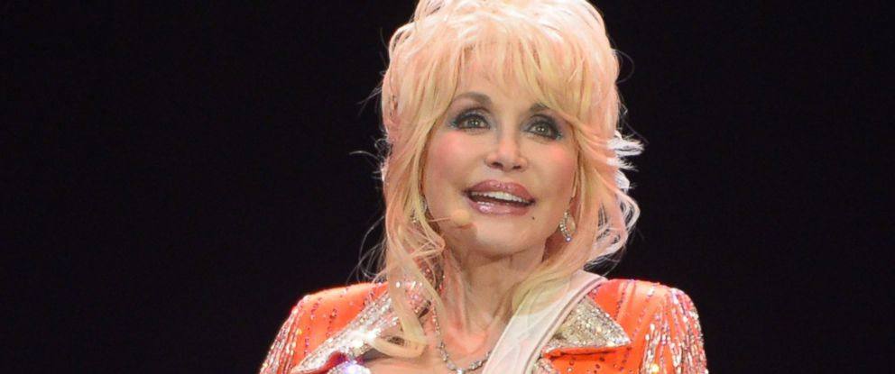 PHOTO: Dolly Parton performs during a concert to benefit Dollys Imagination Library & Dr. Robert F. Thomas Foundation at The University of Tennessees Thompson-boling Arena on May 28, 2014 in Knoxville, Tenn.