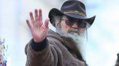 PHOTO: Phil Robertson waves to the crowd during the 87th Annual Macy's Thanksgiving Day Parade in New York, Nov. 28, 2013.