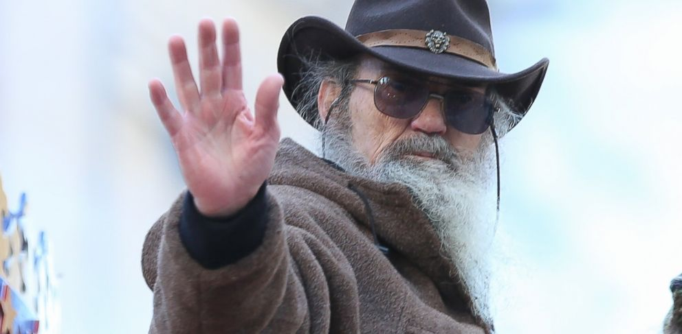 PHOTO: Phil Robertson waves to the crowd during the 87th Annual Macys Thanksgiving Day Parade in New York, Nov. 28, 2013.