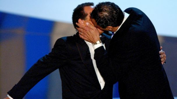 PHOTO: Host Garry Shandling is seen getting kissed by Nominee Brad Garrett for Best Supporting Actor in a Comedy Series at the 55th Annual Primetime Emmy Awards.