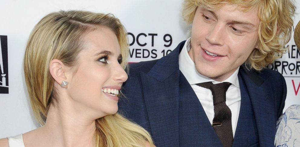 "PHOTO: Emma Roberts and Evan Peters arrive at the premiere of ""American Horror Story: Coven"""